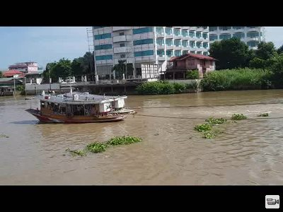 Towing rice barges on the Chao Praya River in Ayutthaya, Thailand